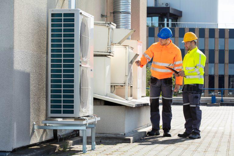 Consultants evaluating ventilation system